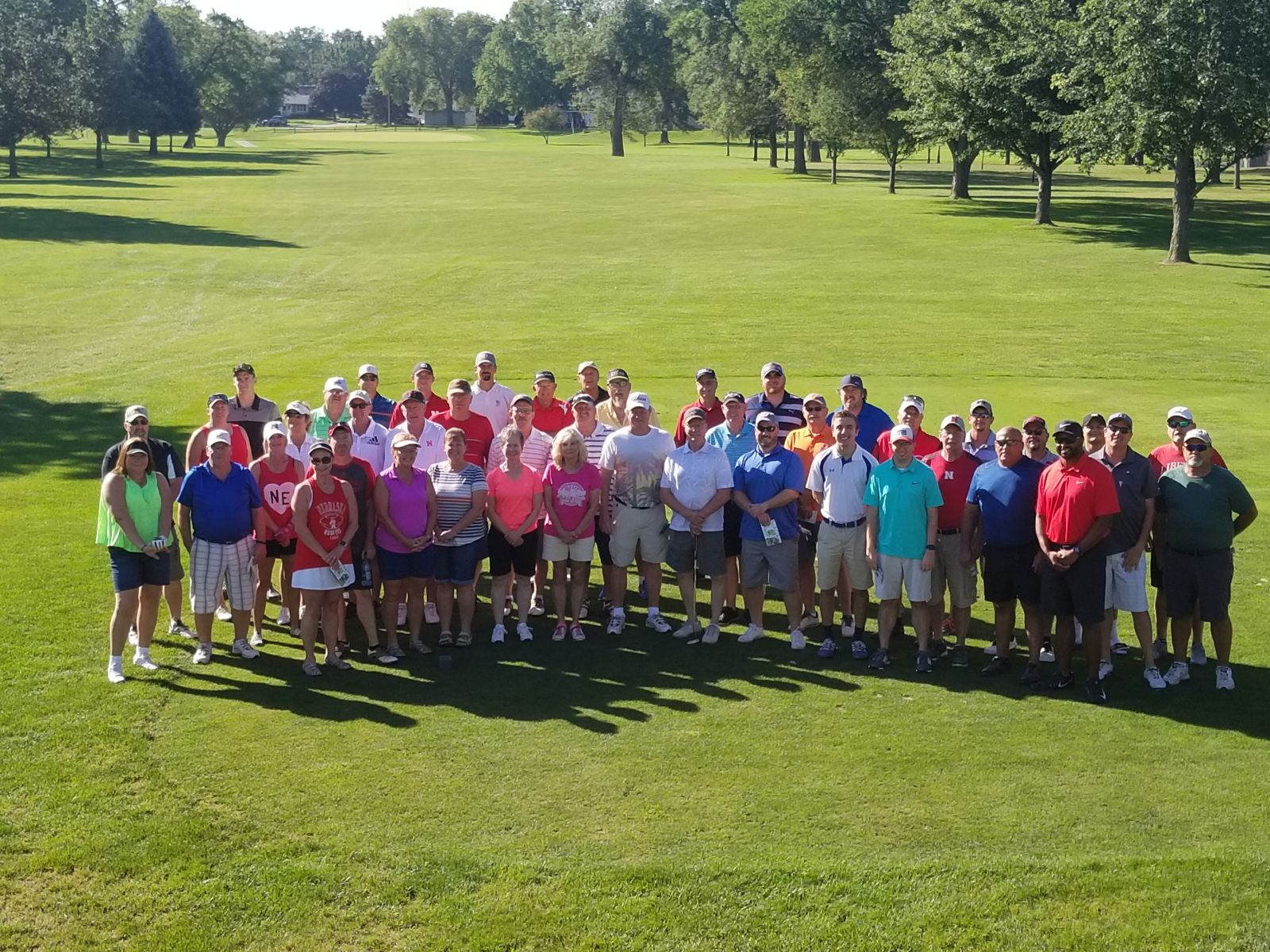 Group poses for photo on Elkhorn Valley golf course after tournament